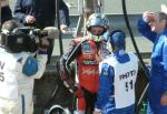 John McGuinness being interviewed in the pits after retiring.