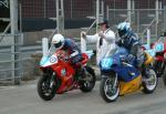 Michael Charnock (number 99) at the Practice Start Line, Douglas.