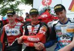 John McGuinness (middle) with Jason Griffiths and Bruce Anstey.