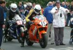 Ian Hutchinson (number 19) leaving TT Grandstand.