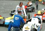 Jean Hergott/Gerald Midrouet's sidecar being filled with petrol at the TT Grandstand, Douglas.