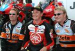 John McGuinness with his team.
