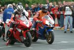 Guy Martin (number 24) leaving TT Grandstand.
