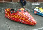 Andrew Couper/Alan Robertson's sidecar at the TT Grandstand, Douglas.