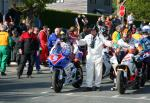 Bruce Anstey (5) at the TT Grandstand, Douglas.