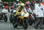 Ian Lougher (number 2) leaving TT Grandstand.