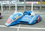Andy Kinsella/Timothy Dixon's sidecar at the TT Grandstand, Douglas.