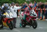 Ryan Farquhar (number 6) leaving TT Grandstand.