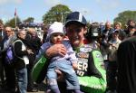 Ryan Farquhar and daughter in the winners' enclosure at the TT Grandstand.